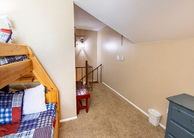 The second guest bedroom is in the upstairs loft and features a twin-over-full bunk bed with a twin trundle.