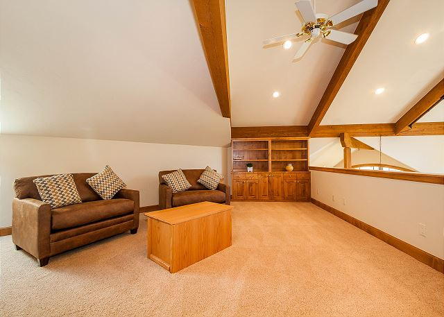 The upstairs loft offers seating, two twin sleeper chairs and a dedicated office space.