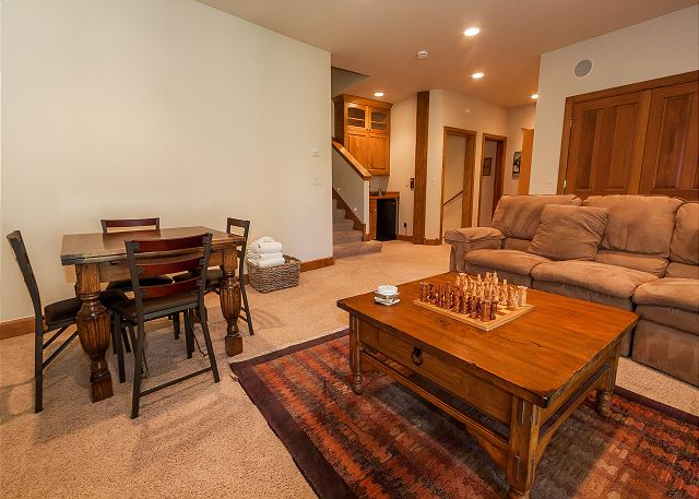 The downstairs den offers comfortable seating, a flat screen TV, Blu-ray player, a wet bar and access to a walk-out patio with a private hot tub.