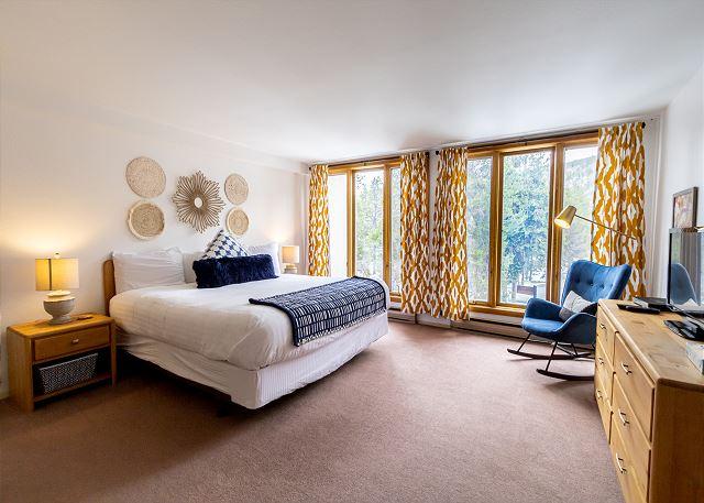 The master bedroom is downstairs and offers a king-sized bed, a flat screen TV and beautiful views