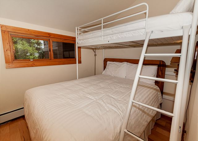 The third guest bedroom is upstairs and features a twin-over-full bunk bed and a flat screen TV