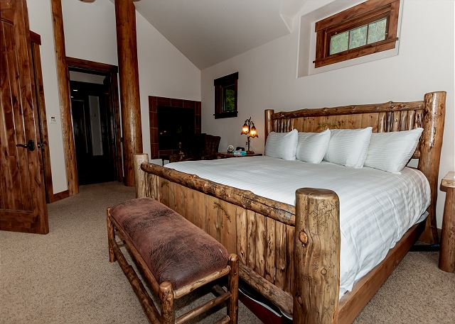 The master suite is on the top level and features a king-sized bed, gas fireplace, a flat screen TV and its own private balcony.
