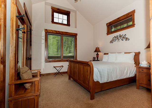 The first guest bedroom is on the second level and features a queen-sized bed and an en suite bathroom