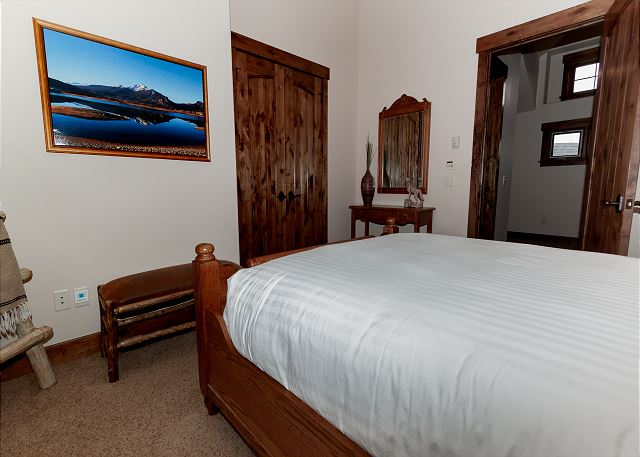 The second guest bedroom is on the second level and features a queen-sized bed.