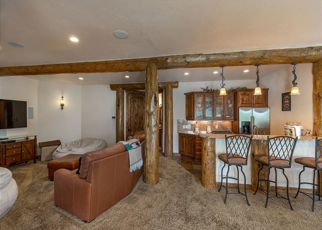 The basement features a recreation room with a media area, full bar, ping pong, foosball and a pinball machine. Plus, a walk-out patio with a private hot tub.