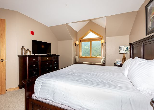 The second master bedroom is upstairs and features a king-sized bed and a flat screen TV.
