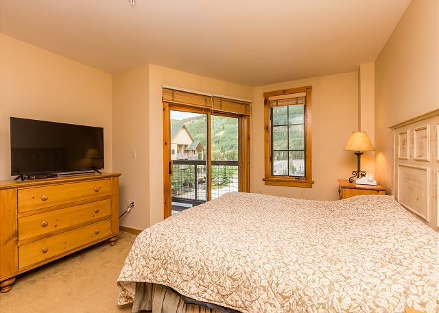 The master bedroom features a king-sized bed, a flat screen TV and DVD player, and its own private balcony.