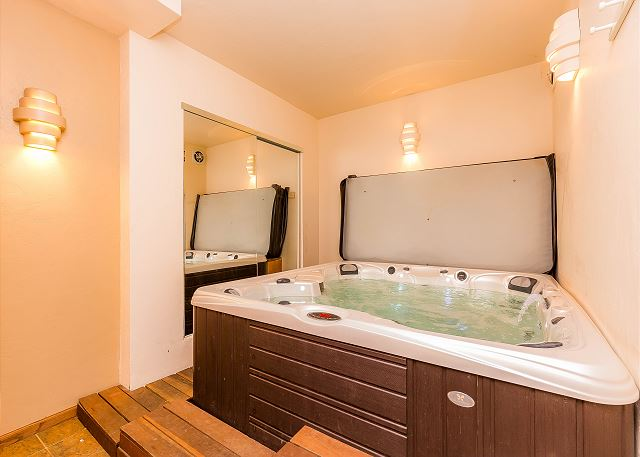 The basement level features a private hot tub.