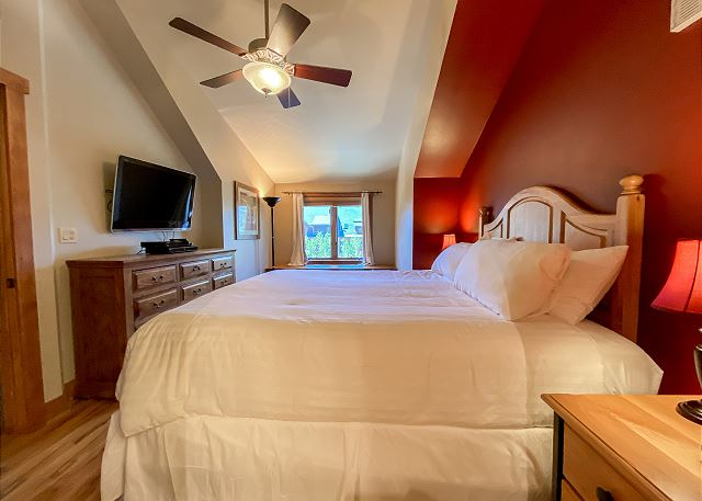 The master bedroom features a king-sized and a flat screen TV.
