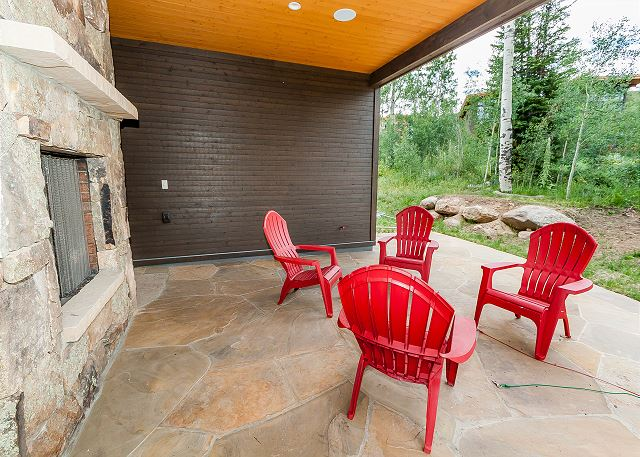 The private patio offers seating and an outdoor fireplace.