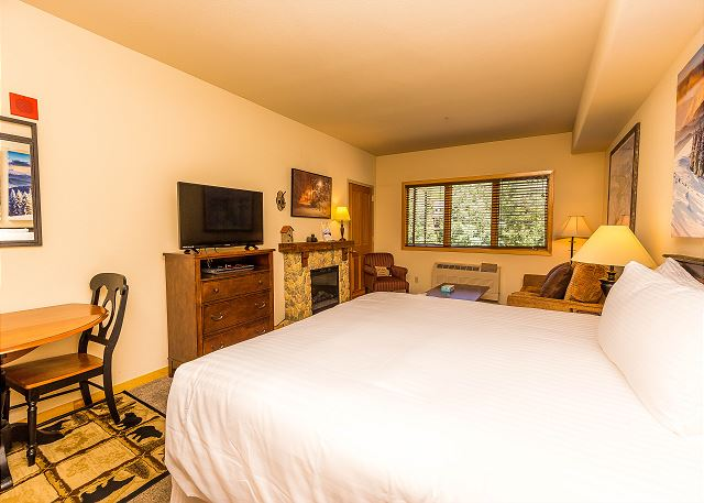 There is a king-sized bed with Ivory White Bedding and queen-sized sleeper sofa.