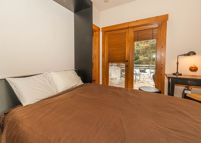 The first guest bedroom also serves as a den and has a queen-sized Murphy bed. It has its own access to the private patio and the guest bathroom.