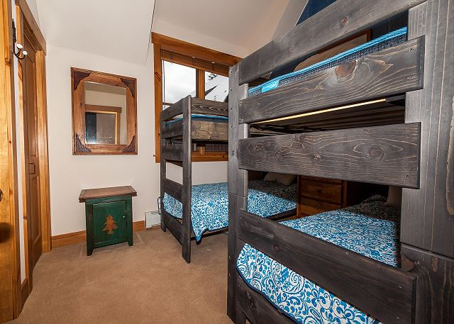 The third guest bedroom is upstairs and features two twin-sized bunk beds and a flat screen TV.