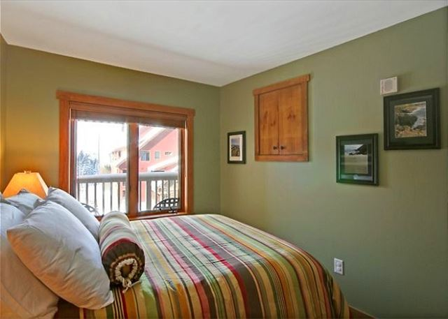 The bedroom features a queen-sized bed and a television that can't be hidden away.