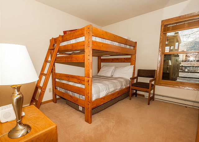 The guest bedroom sleeps four with a full-sized bunk bed and has a flat screen TV.