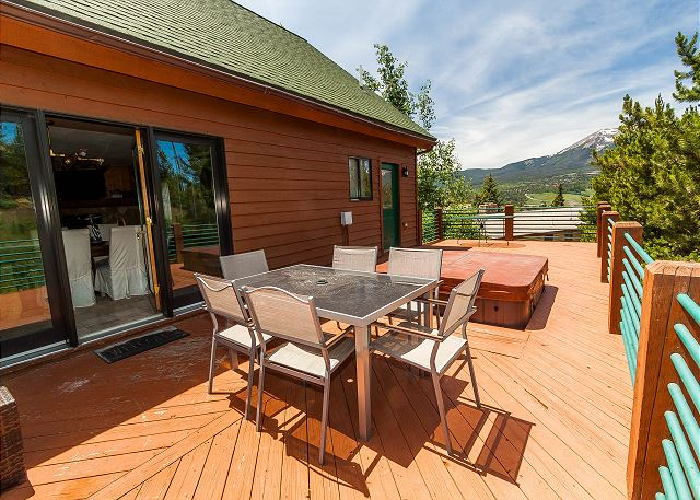 The deck features beautiful views and a private hot tub.