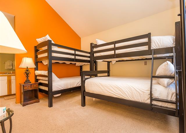 The second guest bedroom features twin-over-twin and twin-over-full bunk beds with Ivory White Bedding.