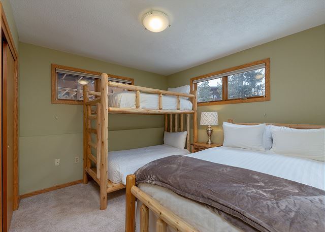 The guest bedroom is in the basement and features a twin-sized bunk bed and a queen-sized bed.