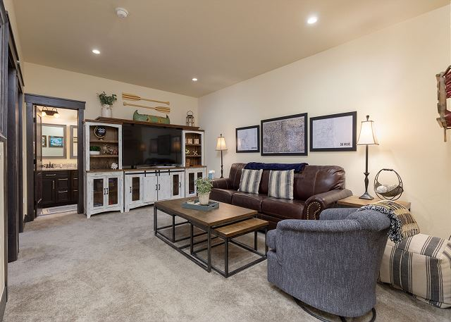 The den is downstairs and features a flat screen TV, Blu-player and a queen-sized sleeper sofa.