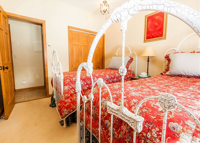 The guest bedroom is in the basement and features two twin-sized beds and its own private patio.