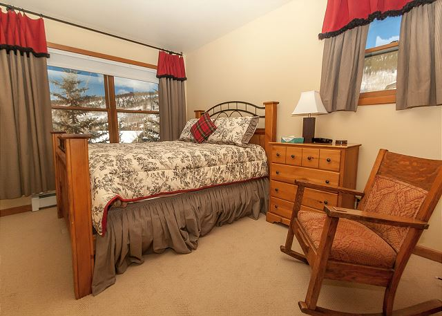 The second master bedroom is upstairs on the third level and features a queen-sized bed.
