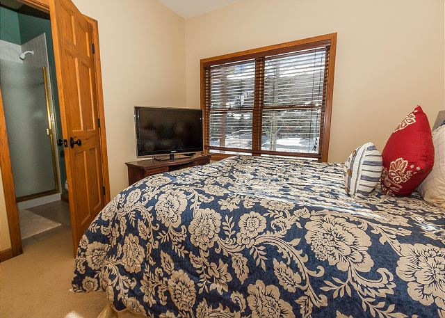 The third master bedroom is in the basement and features a king-sized bed and flat screen TV.