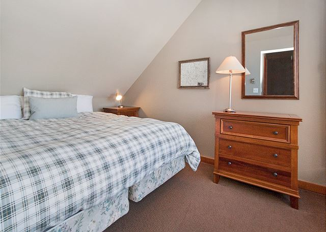 The second guest bedroom is in the upstairs loft and features a king-sized bed and a private balcony with panoramic mountain views.