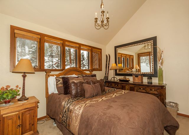 The second guest bedroom features a queen-sized bed.