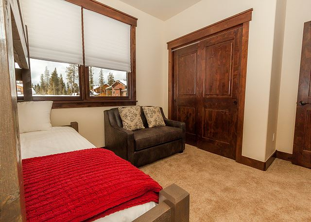 The guest bedroom features a twin-over-full bunk bed and a twin-sized sleeper chair.