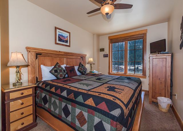 The second master bedroom features a king-sized bed, a flat screen TV and beautiful views.