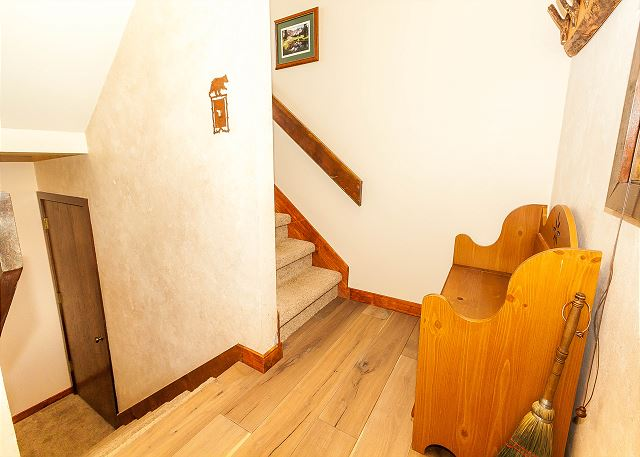 Head downstairs to both guest bedrooms.