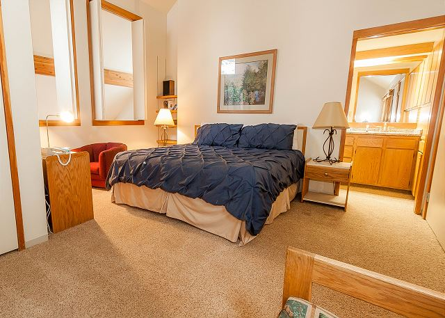 The master bedroom is in the upstairs loft and features a king-sized and a flat screen TV.