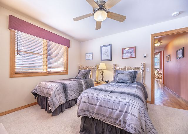 The guest bedroom is on the main level and features two twin-sized beds and flat screen TV.