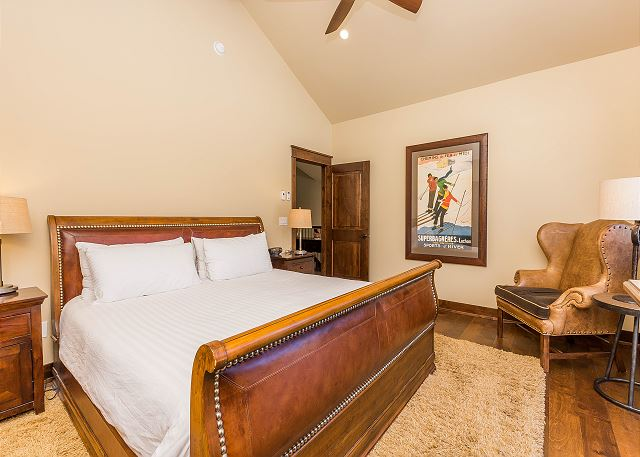 The master suite is on the main level and features a king-sized bed on our Ivory White Bedding program, a flat screen TV and its own private deck.