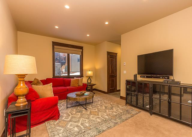 The second living area features a sectional and a flat screen TV. Great for movies and game nights.