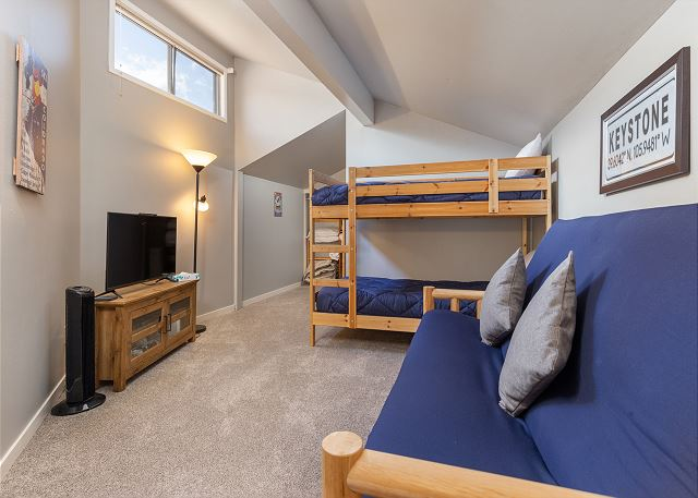 The second guest bedroom is upstairs and features a bunk bed, full-sized futon and a flat screen TV.