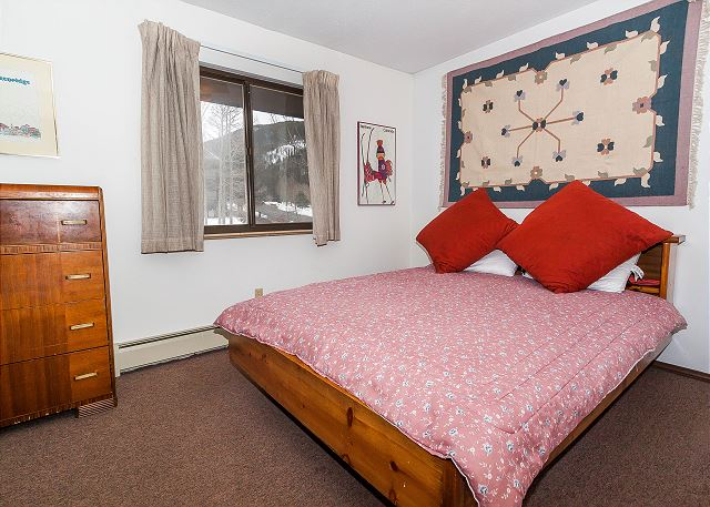 The bedroom features a queen-sized bed.