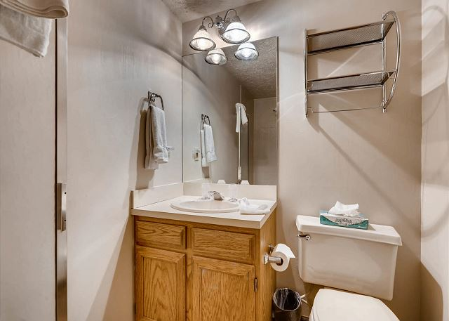 The lower level of the home serves as the fourth bedroom and a bonus living area. There is a queen-sized bed, a twin-sized bunk bed, a cozy seating around a flat screen TV and an Xbox, and a large game table. Plus there is a full bathroom.