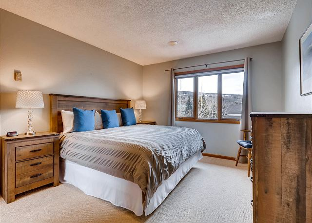 The third bedroom is upstairs and features a king-sized bed.