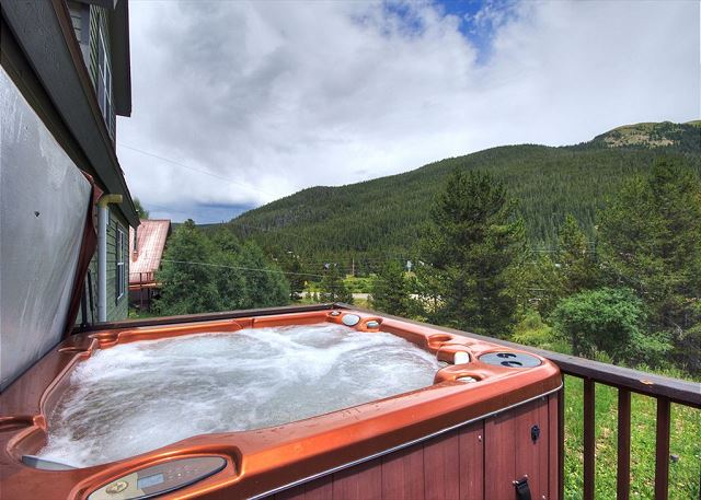 Enjoy panoramic mountain views from the private hot tub.