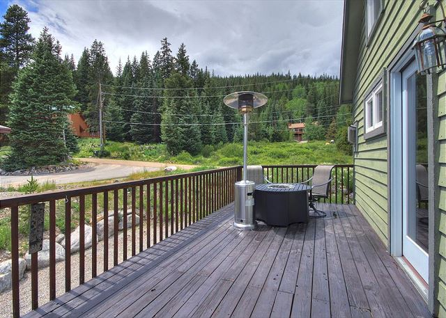 The private deck features a hot tub, gas grill and a fire pit.