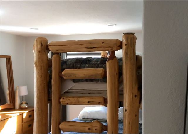 The second guest bedroom features a twin-over-queen bunk bed.