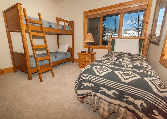The second guest bedroom is on the lower level and features a twin-sized bunk bed and another twin bed. It also has its own access to the guest bathroom.