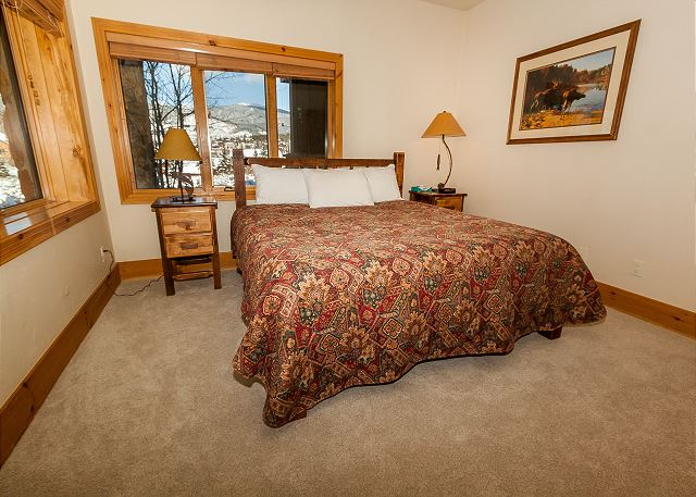 The third master suite is on the lower level and features a king-sized bed.