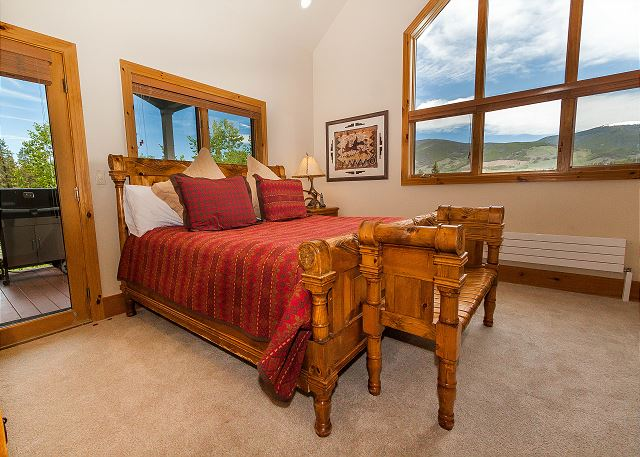The first master bedroom is on the main level and features a king-sized bed, a flat screen TV, a gas fireplace and its own access to the deck off the kitchen.