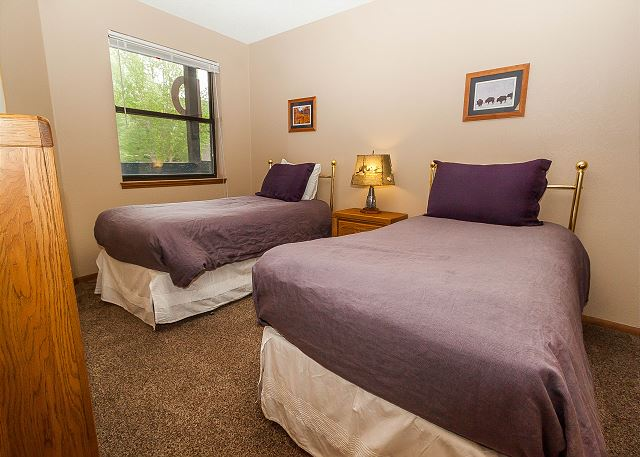 The guest bedroom features two twin-sized beds.