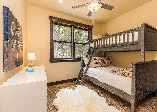 The second guest bedroom is on the third level and features a twin-over-full bunk bed with Ivory White Bedding and an en suite bathroom.