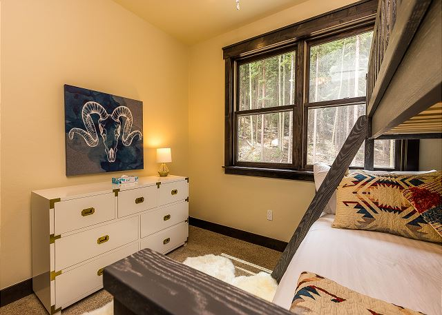 The second guest bedroom is on the third level and features a twin-over-full bunk bed and an en suite bathroom.
