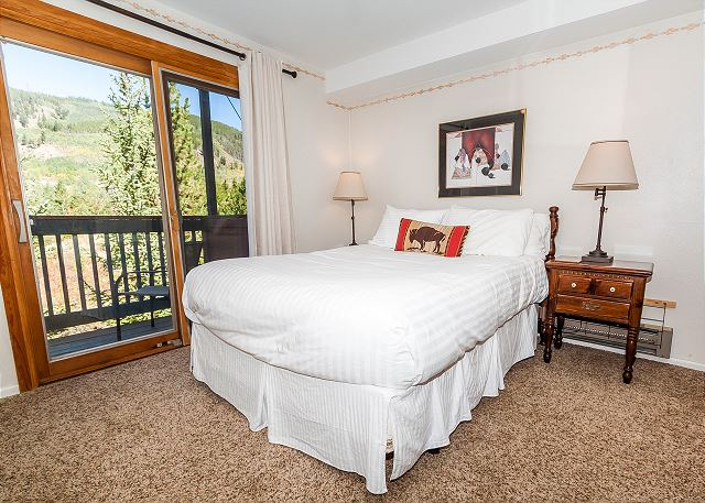 The master suite features a queen-sized bed with Ivory White Bedding, a flat screen TV and its own private balcony.