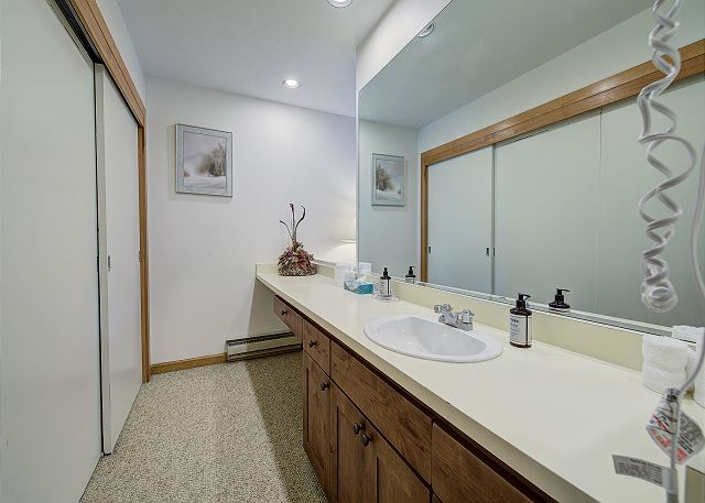 The bedroom has a private quarter bath that also has access to the full guest bathroom.